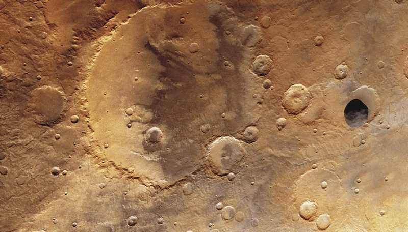 Image: 0028233714, License: Rights managed, Restrictions: Not available for use in Corbis Merchandise. Image available for use in Corbis Mobile Offerings., Martian moon Phobos, the grey object to the right, high above Herschel Crater on Mars. The crater is sixty miles in diameter. Viking Orbiter 1, September 26, 1977, Property Release: No or not aplicable, Model Release: No or not aplicable, Credit line: ., Corbis